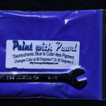 25 Gram Bag of Blue Thermochromic Paint Pigment Heating up.