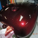 """Fire Red Motorcycle tank sprayed with our .004"""" Fire Red Flake."""