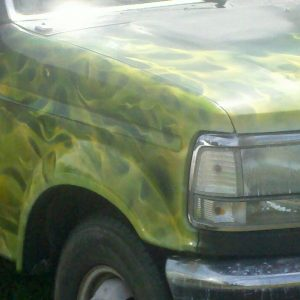 Multiple green and yellow flames on truck hood